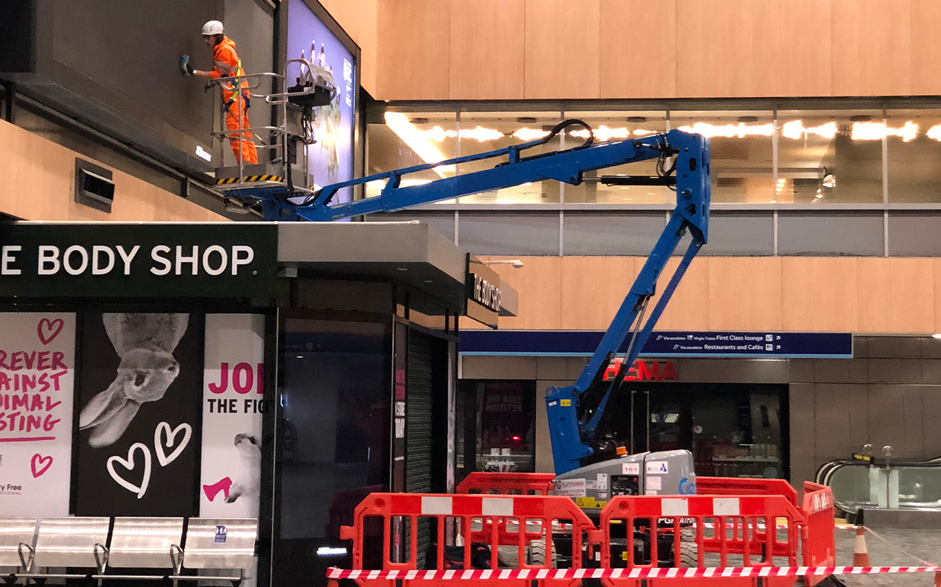 Boom lift hired to clean an advertising screen