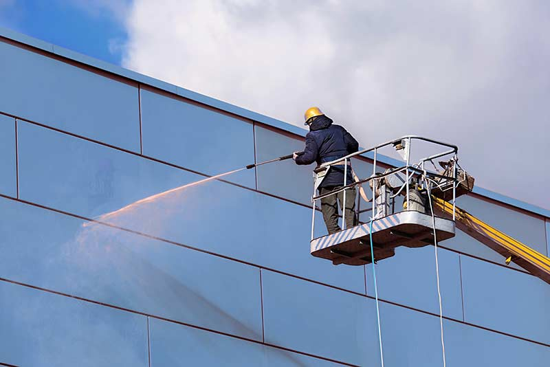 Using an access platform to clean cladding
